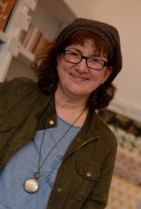 Headshot of smiley Debbie Young