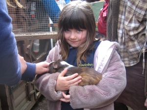 Brownie the guinea pig with Laura the Brownie