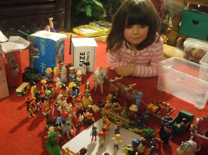 Laura with arrangement of Playmobil figures