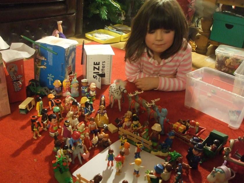 Laura with arrangement of Playmobil figures