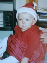 Photo of my daughter in Santa outfit, aged 7 months