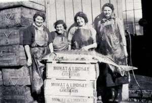 Girls processing fish