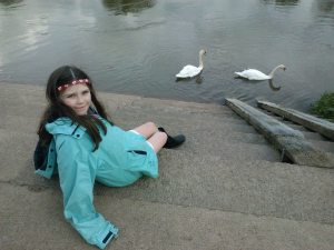 My daughter and two swans on the Wye