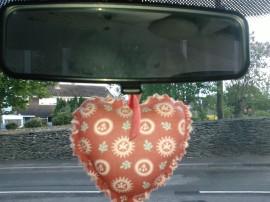 heart-shaped air freshener in my car