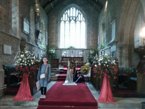 flower arrangements on the alter