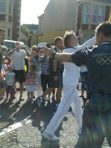 Olympic torchbearer passes by