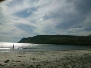 Little girl in a big sea at Glenbrittle, Skye