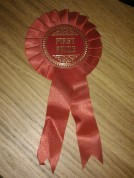 Red rosette for first prize winners at Haweskbury Horticultural Show