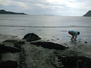 Laura beachcombing at Glenbrittle,Skye