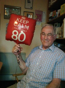"Grandpa on his 80th birthday with a ""Keep Calm You're Only 80"" balloon"