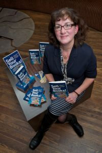 Me at my book launch with some of my books