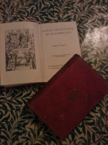 Two old copies of Lewis Carroll books - Alice In Wonderland and Through The Looking Glass