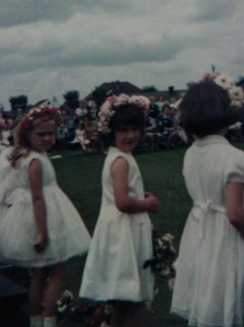 Me, centre, aged 6, as a May Maiden on the school field