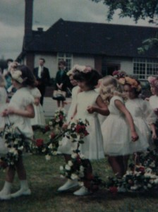 Procession of children in traditional May Day ceremony at English primary school
