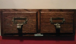 Old-fashioned wooden library filing drawers, viewed from the front
