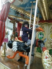 Laura takes a turn on the carousel