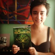 Amira Makansi with a copy of The Sowing
