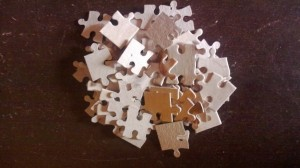 Pile of unsorted jigsaw puzzle pieces