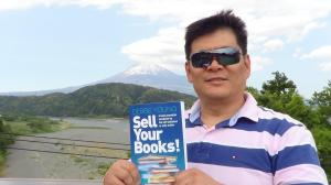 My friend Norio in front of Mount Fuji with my book