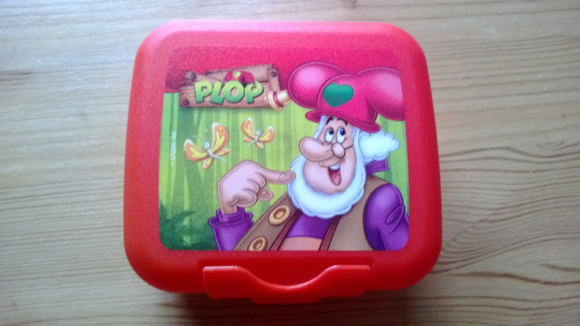 Plastic box with the Gnome Plop on the lid