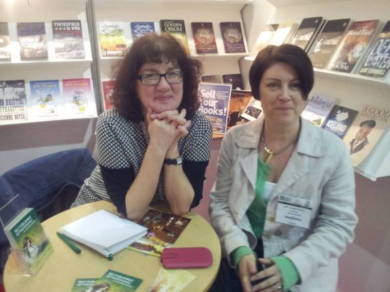 Debbie Young and Joanne Phillips seated at a table on the SilverWood stand