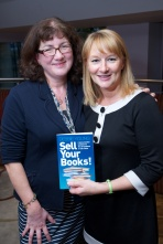 "Debbie Young and Sandy Osborne with a copy of ""Sell Your Books!"""