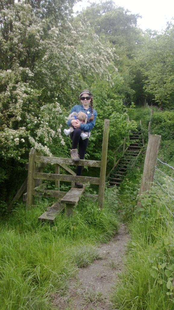 Laura crossing a stile