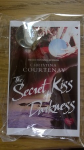 Promotional card showing cover of novel with tiny crystal ball attached