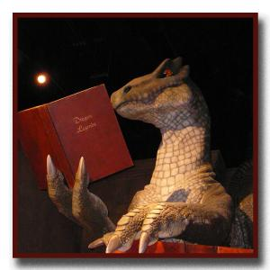 Picture of a dragon reading a book