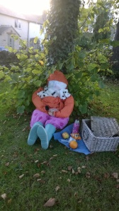 Scarecrow with picnic basket