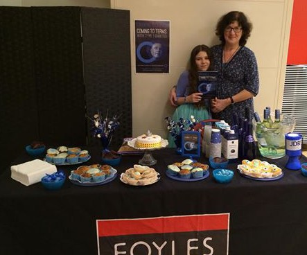 Debbie and Laura Young by the table of cakes!