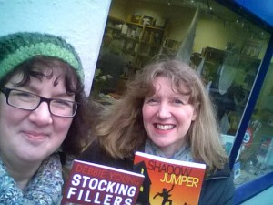 Julia Forster and me outside the Nailsworth branch of the Yellow-Lighted Bookshop, where we'd just delivered new stocks our the books we're holding