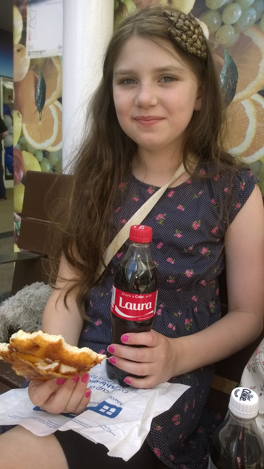 Laura with a bottle of Coke