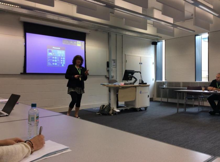 Debbie Young giving a talk in a lecture room