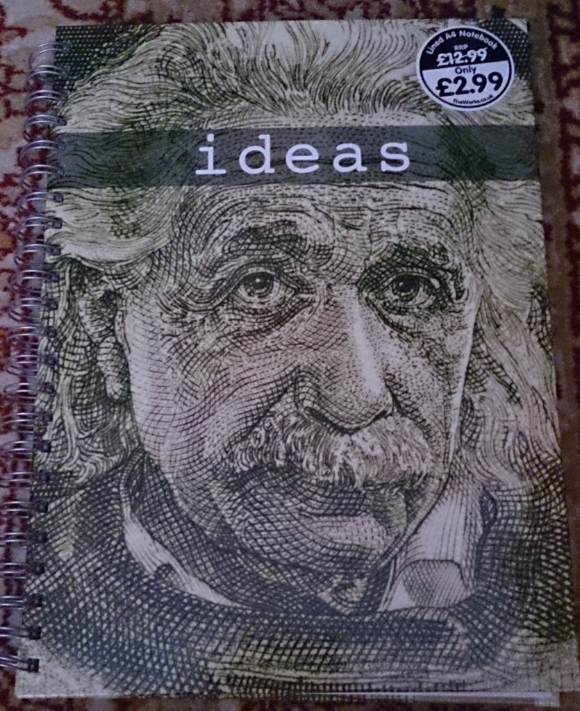 "Notebook showing Einstein's head and caption ""Ideas"""