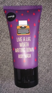 """Body wash tube bearing the caption """"live a life worth writing down"""""""