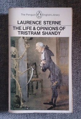 Cover image of Tristram Shandy book showing man facing grim reaper in skeletal form