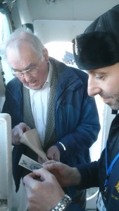 Photo of my dad with tour guide looking at old photos