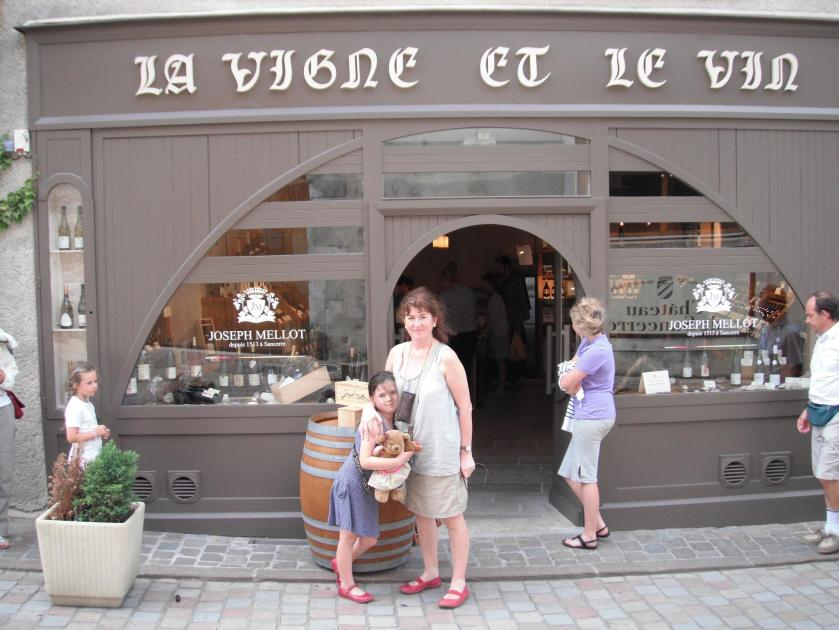 Photo of Debbie and daughter outside French wine shop