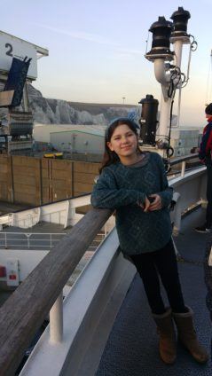 Laura on ferry in front of White Cliffs of Dover