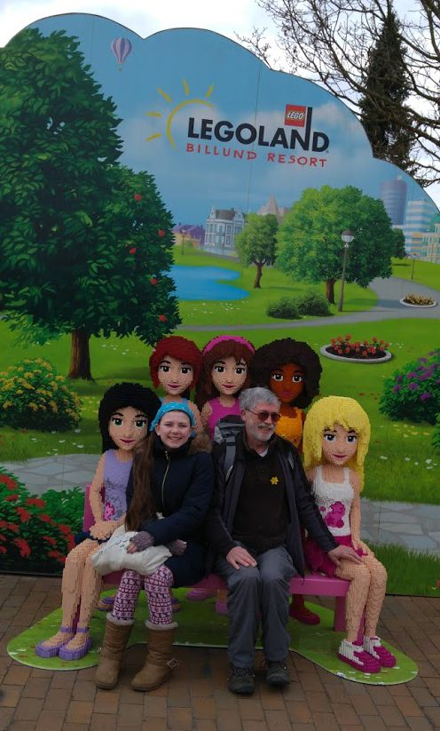 Gordon and Laura on a bench with Lego model girls