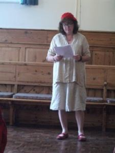 Photo of Debbie reading in the Quaker Meeting House