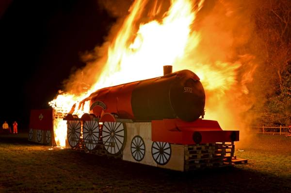 Picture of giant model of train in bonfire