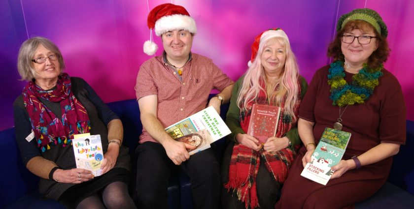 Photo of four authors on TV studio sofa