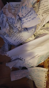 pile of screwed up handwritten manuscripts
