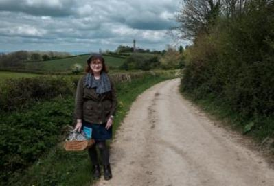 picture of Debbie on winding footpath with the Hawkesbury Monument in the distance