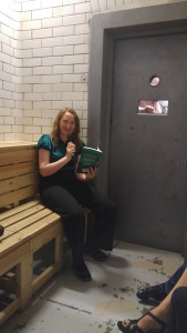 photo of the author reading from her book in the cell
