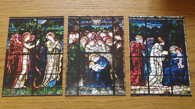 photo of postcards of stained glass window nativity scenes
