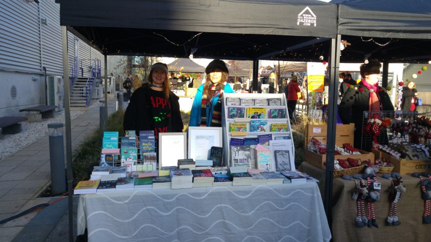 photo of two authors on an outdoor bookstall
