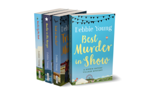 Image of first four books in the Sophie Sayers Village Mysteries series